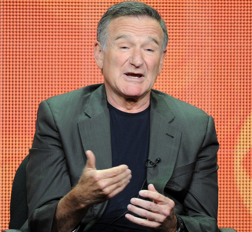 """. FILE - In this July 29, 2013 file photo, actor Robin Williams participates in the \""""The Crazy Ones\"""" panel at the 2013 CBS Summer TCA Press Tour at the Beverly Hilton Hotel in Beverly Hills, Calif.  (Photo by Frank Micelotta/Invision/AP, File)"""