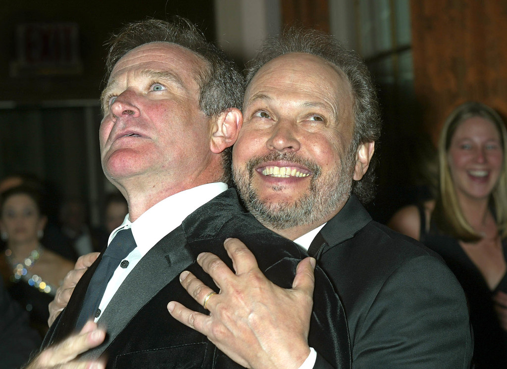 . Actor Robin Williams, left, shares a light moment with fellow actor Billy Crystal prior to the 18th annual American Museum of the Moving Image benefit in New York Wednesday, Feb. 12, 2003.    (AP Photo/Shawn Baldwin)