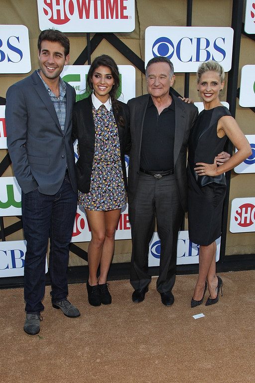 . Actors (L-R) James Wolk, Amanda Setton, Robin Williams, and Sarah Michelle Gellar attend the CW, CBS and Showtime 2013 summer TCA party on July 29, 2013 in Los Angeles, California.  (Photo by Paul A. Hebert/Invision/AP)