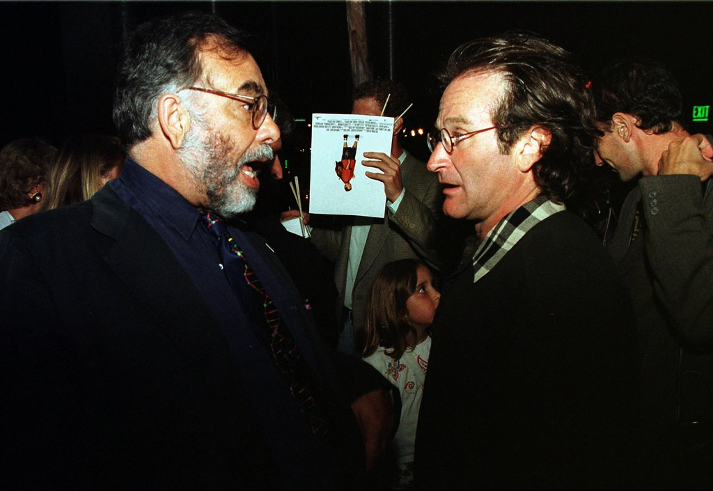 """. Actor Robin Williams, right, chats with director Francis Ford Coppola during a post premiere party of \""""Jack\"""" at San Francisco\'s Exploratorium, Tuesday, July 30, 1996. . (AP Photo/Andy Kuno)"""