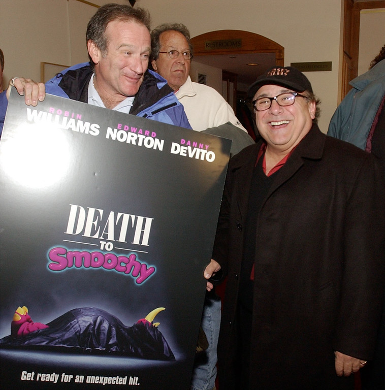 ". Robin Williams and Danny Devito clown with a poster promoting their new movie, ""Death to Smoochy\"" just prior to the special screening at the US Comedy Arts Festival, Thursday, Feb. 28, 2002 in Aspen, Colo. (AP Photo/ E Pablo Kosmicki)"