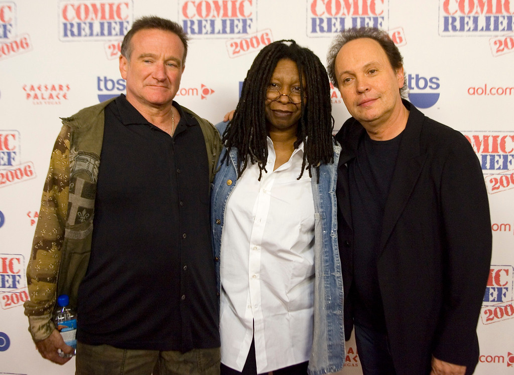 ". This Nov. 18, 2006 file photo shows comedians Robin Williams, from left, Whoopi Goldberg and Billy Crystal posing after hoasting ""Comic Relief\"" at Caesars Palace Hotel and Casino in Las Vegas, Nev.   (AP Photo/Keith Shimada, File)"