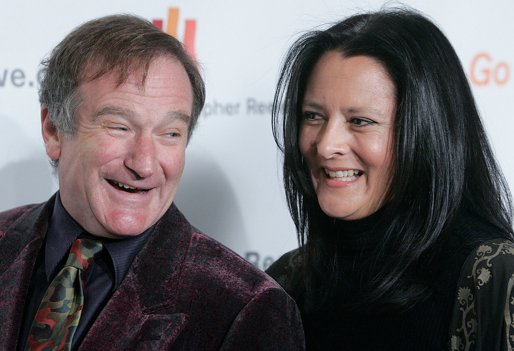 . Robin Williams laughs with his wife Marsha Garces Williams as they arrive at the Christopher Reeve Foundation\'s A Magical Evening gala Thursday, Nov. 17, 2005 in New York.  (AP Photo/Stephen Chernin)