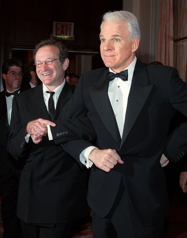 . Comedian Steve Martin, right, takes fellow comedian Robin Williams by the arm as they pose for photographers Friday, March 3, 2000, in New York.  (AP Photo/Louis Lanzano)