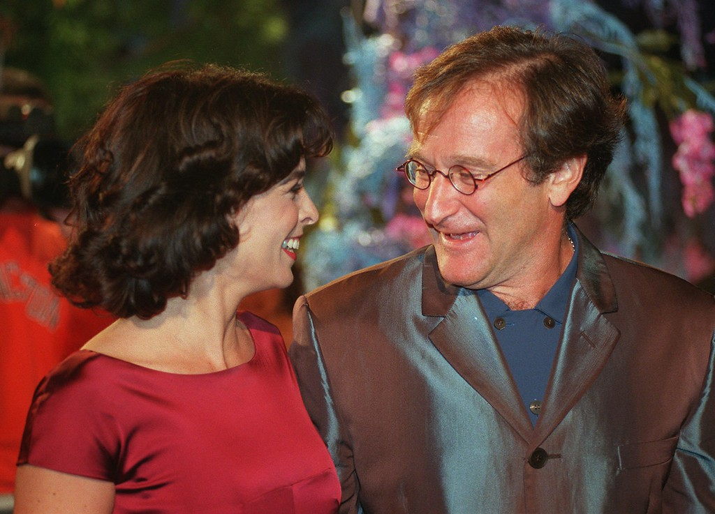 """. Annabella Sciorra and Robin Williams, co-stars in the new Polygram film \""""What Dreams May Come,\"""" mingle at the premiere of the film Monday, Sept. 28, 1998, at the Academy of Motion Picture Arts & Sciences in Beverly Hills, Calif.  (AP Photo/Chris Pizzello)"""