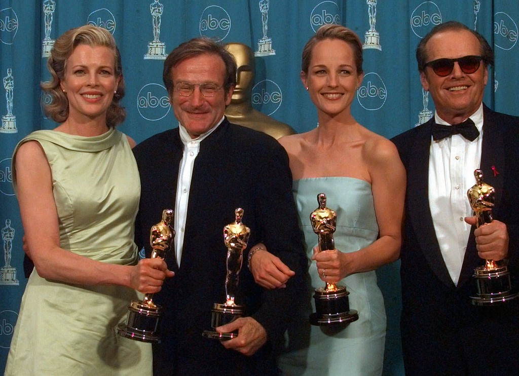 ". Kim Basinger, Robin Williams, Helen Hunt and Jack Nicholson, from left to right, pose with their Oscars at the Shrine Auditorium in Los Angeles, Monday, March 23, 1998.   Basinger and Williams won Best Supporting Actress and Actor, for ""L.A. Confidential\"" and \""Good Will Hunting\"" respectively, Hunt and Nicholson won Best Actress and Actor, both for \""As Good As It Gets.\"" (AP Photo/Reed Saxon)"