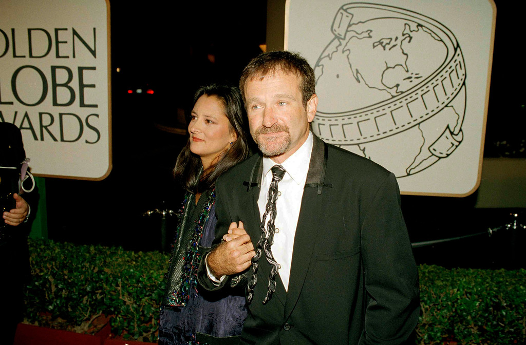 """. Actor and comedian Robin Williams and his wife Marsha Garces, arrive at the 51st Annual Golden Globe Awards in Beverly Hills, Calif., Jan. 22, 1994. Williams won Best Actor in a Musical and Comedy Film for \""""Mrs. Doubtfire.\"""" (AP Photo/Mark J. Terrill)"""