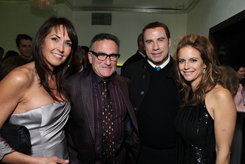 """. Susan Schneider, Robin Williams, John Travolta and Kelly Preston at the World Premiere of Walt Disney Pictures \""""Old Dogs\"""" on November 09, 2009 at the El Capitan Theatre in Hollywood, California. (Photo by Eric Charbonneau/Invision/AP Images)"""