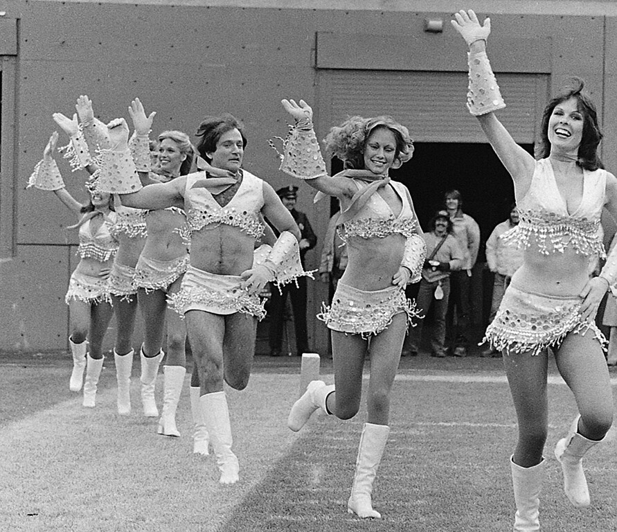 ". This Nov. 12, 1979 file photo shows actor-comedian Robin Williams, third from right, dressed as a cheerleader with the Broncos\' Pony Express cheerleaders during the filming of an episode of ""Mork & Mindy,\"" in Denver.  (AP Photo/File)"