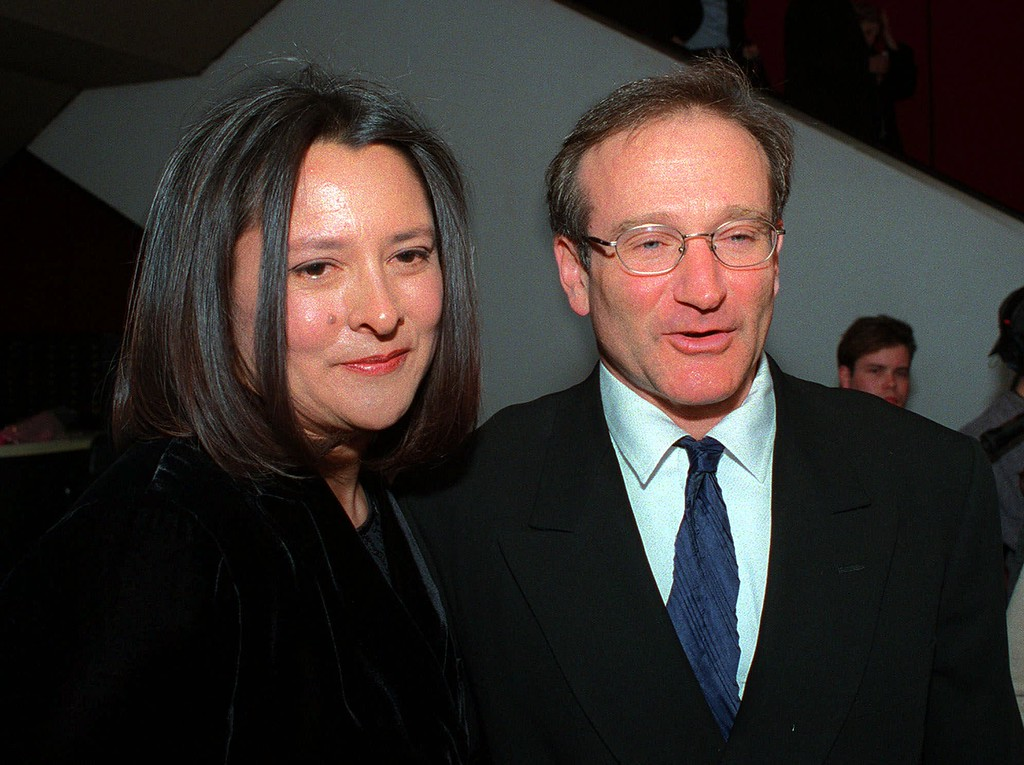 """. Producer Marsha Garces Williams and her husband, actor Robin Williams, arrive Thursday, February 25, 1999 at the New York premiere of Tennessee Williams\' play \""""Not About Nightingales.\"""" (AP Photo/Mitch Jacobson)"""