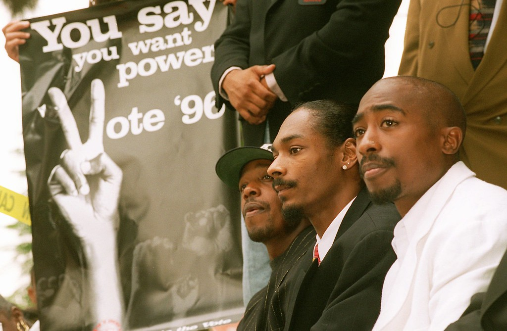 ". File - Rappers, right to left, Tupac Shakur, Snoop Doggy Dogg and Hammer, joined the black-activists group Brotherhood Crusade Thursday, Aug. 15, 1996, in Los Angeles to kick off a campaign against the ""three-strikes\"" law and to oppose the California Civil Rights Initiative, the anti-affirmative action measure. (AP Photo/Frank Wiese)"