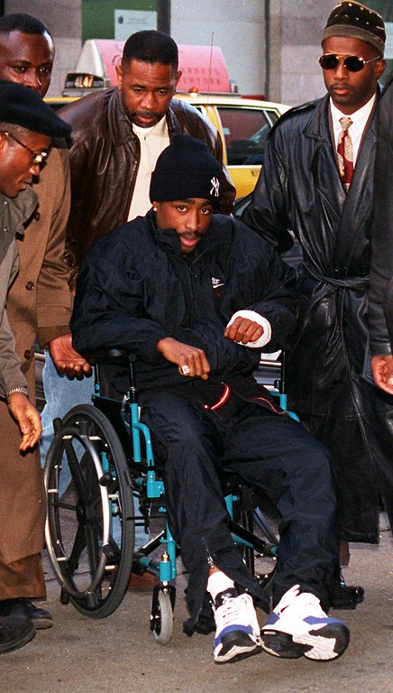 . Rap star Tupac Shakur arrives at Manhattan Supreme Court in New York on Dec. 1, 1994.  He was injured in a shooting.  (AP Photo/Eric Miller)