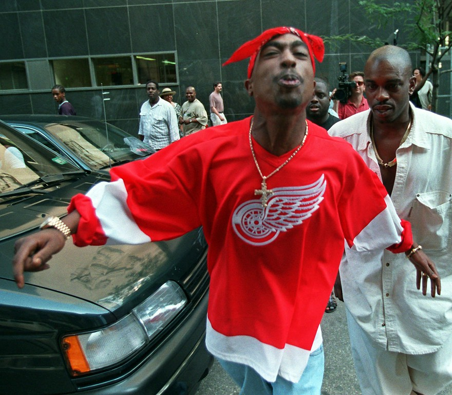 . Rap star Tupac Shakur spits in the direction of reporters as he leaves state Supreme Court in New York July 5, 1994. (AP Photo/Bebeto Matthews)