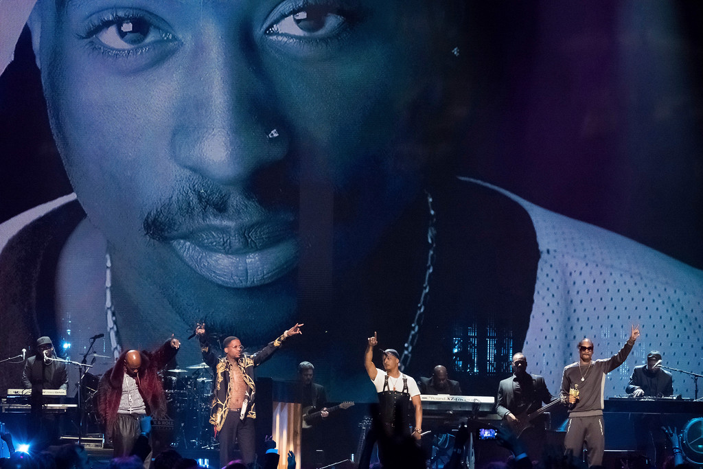 . Treach, from left, T.I., YG and Snoop Dogg perform a tribute to inductee Tupac Shakur at the 2017 Rock and Roll Hall of Fame induction ceremony at the Barclays Center on Friday, April 7, 2017, in New York.  Shakur died on September 13, 1996.  (Photo by Charles Sykes/Invision/AP)
