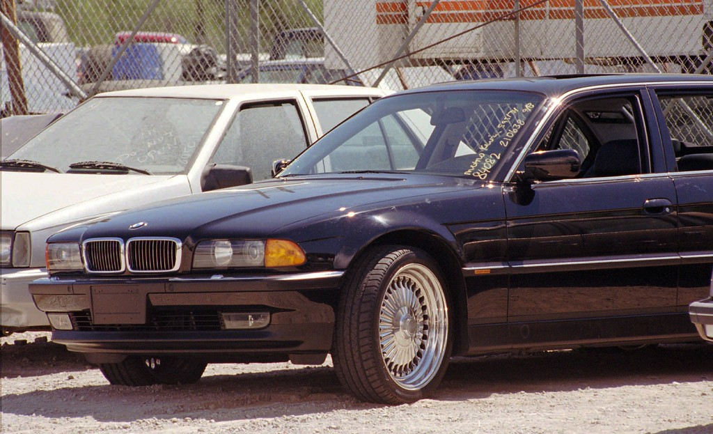 . A black BMW, riddled with bullet holes, sits in the police impound lot Sunday, Sept. 8, 1996, in Las Vegas. Rapper Tupac Shakur was shot and critically wounded while riding in the car driven by Death Row Records chairman Marion Knight late Saturday night after attending the heavyweight fight between Mike Tyson and Bruce Seldon. (AP Photo/Lennox McLendon)