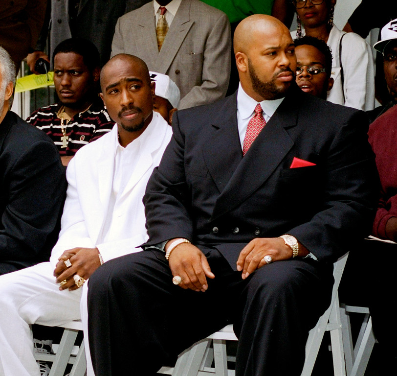 ". FILE - In this Aug. 15, 1996, file photo, rapper Tupac Shakur, left, and a founder of Death Row Records, Marion ""Suge\"" Knight, attend a voter registration event in South Central Los Angeles.   (AP Photo/Frank Wiese, File)"
