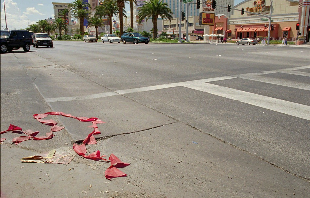 ". The intersection of Harmon and Las Vegas Blvd., in Las Vegas, Sunday, Sept. 8, 1996, where rap superstar Tupac Shakur and Death Row Records Chairman Marion ""Suge\"" Knight were stopped and transported to the University Medical Center-Trauma unit after being shot.  (AP Photo/Jack Dempsey)"