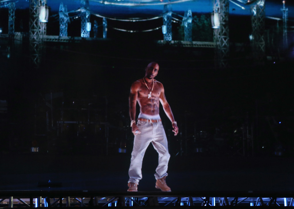 . A hologram of rapper Tupac Shakur performing onstage at the 2012 Coachella Valley Music & Arts Festival on April 15, 2012 in Indio, California.  Shakur died on September 13, 1996.  (Photo by Christopher Polk/Getty Images for Coachella)