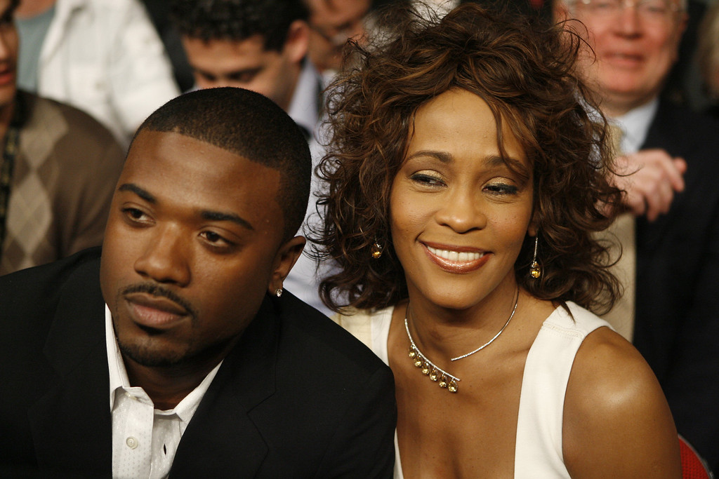 . FILE - In this April 19, 2008 file photo, singers Ray J, left, and Whitney Houston attend the Bernard Hopkins and Joe Calzaghe, of Britain, light heavyweight boxing match at the Thomas & Mack center in Las Vegas.   (AP Photo/Isaac Brekken, file)