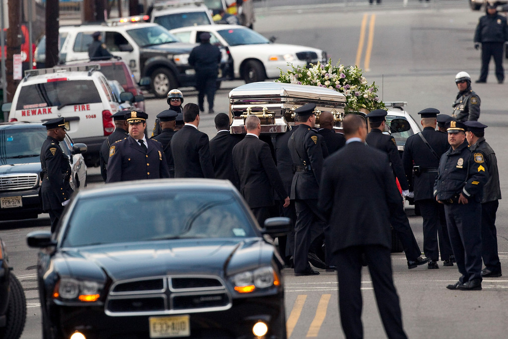 . Pallbearers carry the casket of Whitney Houston to a hearse outside New Hope Baptist Church after funeral services on February 18, 2012 in Newark, New Jersey. Whitney Houston was found dead in her hotel room at The Beverly Hilton hotel on February 11, 2012. (Photo by Michael Nagle/Getty Images)