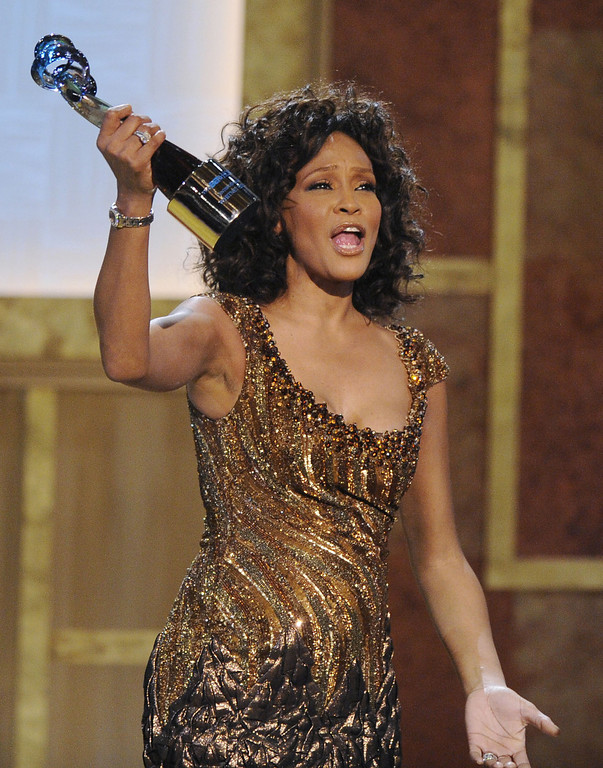 . FILE - In this Saturday, Jan. 16, 2010 file photo, Whitney Houston accepts an award at the Warner Theatre during the 2010 BET Hip Hop Honors in Washington. Houston died Saturday, Feb. 11, 2012, she was 48. (AP Photo/Nick Wass)