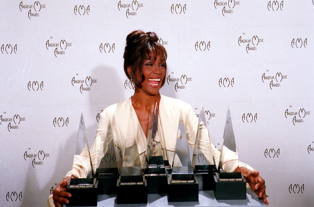 . Singer Whitney Houston poses backstage with her seven awards at the 21st annual American Music Awards in Los Angeles, Ca., Feb. 7, 1994.   (AP Photo/Douglas Pizac)