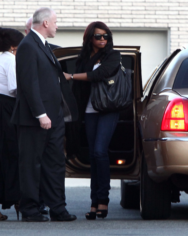 . Bobbi Kristina Houston arrives at Whigham Funeral Home for a private viewing for her mother Whitney Houston on February 17, 2012 in Newark, New Jersey. Whitney Houston was found dead in her hotel room at The Beverly Hilton hotel on February 11, 2012.  (Photo by Paul Zimmerman/Getty Images)