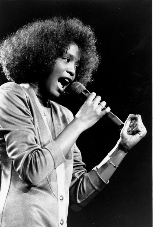. American singer Whitney Houston belts out a song during her segment of a benefit concert at Boston Garden Saturday night on May 10, 1986.  (AP Photo/Elise Amendola)