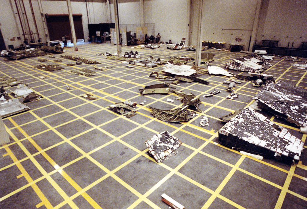 . Pieces of the Space Shuttle Challenger are arranged in a hangar after being salvaged from the Atlantic Ocean where they were scattered, on January 28, 1986 when the spacecraft exploded. Space Shuttle Challenger exploded on January 28, 1986 seconds after blast-off, killing seven astronauts, putting all space flights on hold for 32 months.        (STF/AFP/Getty Images)