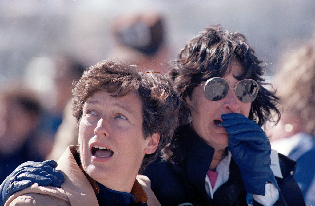 . Two unidentified spectators at the Kennedy Space Center react after they witnessed the explosion of the space shuttle Challenger, Jan. 28, 1986.  The shuttle, which carried a crew of seven, exploded just moments after takeoff.  (AP Photo)