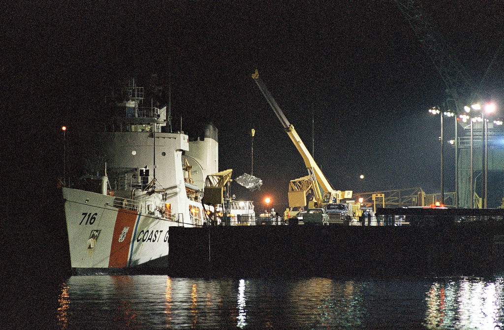 . Debris from the ill-fated Space Shuttle Challenger is unloaded by from Coast Guard cutter Dallas, Feb. 19, 1986. The explosion of the Space Shuttle Challenger on January 28 killed all seven crew members. (AP Photo)
