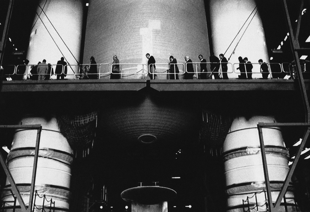 . In this 1986 file picture, members of the Presidential Commission on the Space Shuttle Challenger Accident walk past the solid rocket boosters and the external tank of a shuttle being fitted in the Vehicle Assembly building at Kennedy Space Center in Cape Canaveral, Fla. (AP Photo/Pool, File)