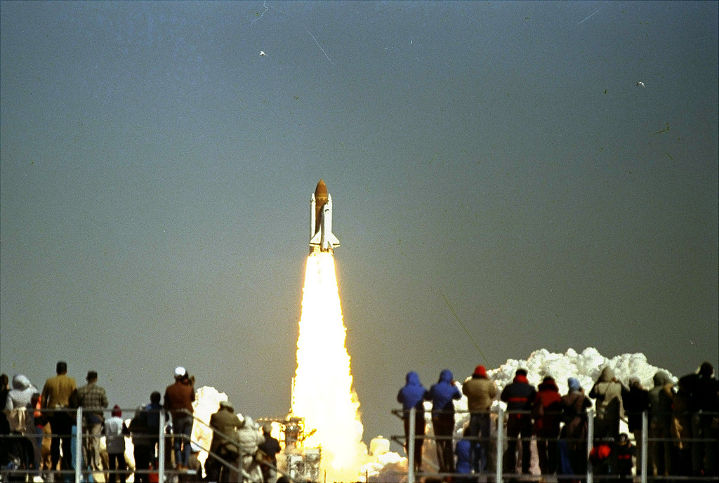 . Spectators in the VIP area at the Kennedy Space Center, Fla., watch as the Space Shuttle Challenger lifts from Pad 39-B, January 28, 1986. The shuttle, carrying a crew of seven, including the first teacher in space, exploded about 73 seconds after launch. All were killed. (AP Photo/Bruce Weaver)
