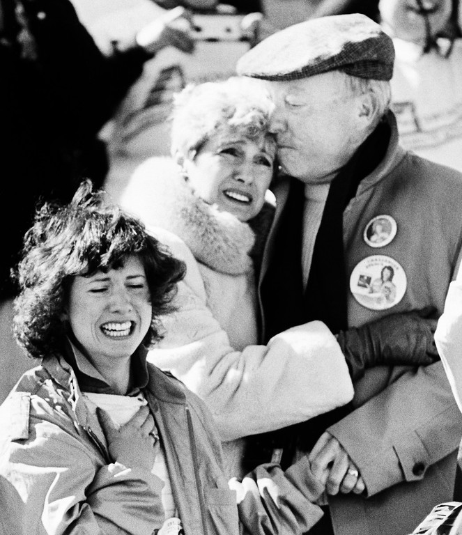 . The family of Christa McAuliffe, a teacher who was America\'s first astronaut, realize the horror after the Space Shuttle orbiter Challenger blew apart after liftoff from Kennedy Space Center, Florida, Tuesday, Jan. 28, 1986. The sister of Christa, Betsy, left, and parents Grace and Ed Corrigan console each other after the explosion. (AP Photo/Jim Cole)