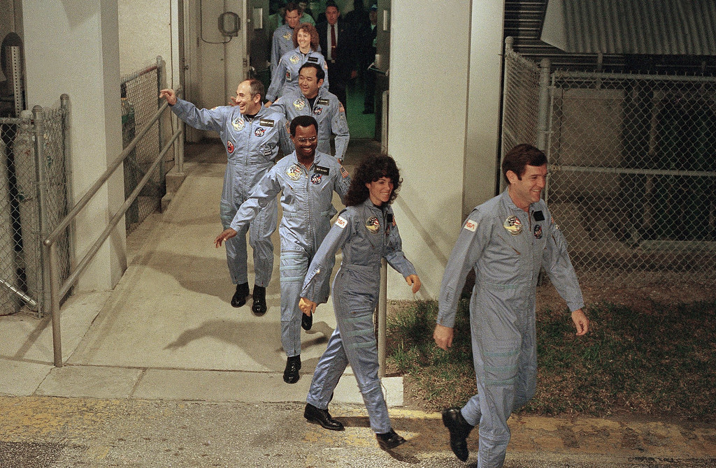 . The crew for the Space Shuttle Challenger flight 51-L leaves their quarters for the launch pad, Jan. 27, 1986, at the Kennedy Space Center in Florida.  Front to back are Commander Francis Scobee, Mission Spl. Judith Resnik, Mission Spl. Ronald McNair, Payload Spl. Gregory Jarvis, Mission Spl. Ellison Onizuka, teacher Christa McAuliffe, and pilot Michael Smith. (AP Photo/Steve Helber)