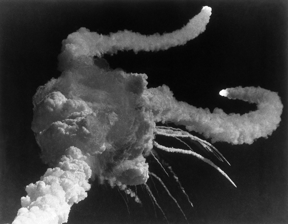 . The Space Shuttle mission 51-L explodes after liftoff from Kennedy Space Center, Florida, Jan. 28, 1986 with a crew of seven aboard. The explosion came after liftoff but NASA officials say there were no apparent problems at the time. The Space Shuttle orbiter Challenger also was reported to have exploded on impact in the water Challenger also was reported to have exploded on impact in the water. (AP Photo/Steve Helber)