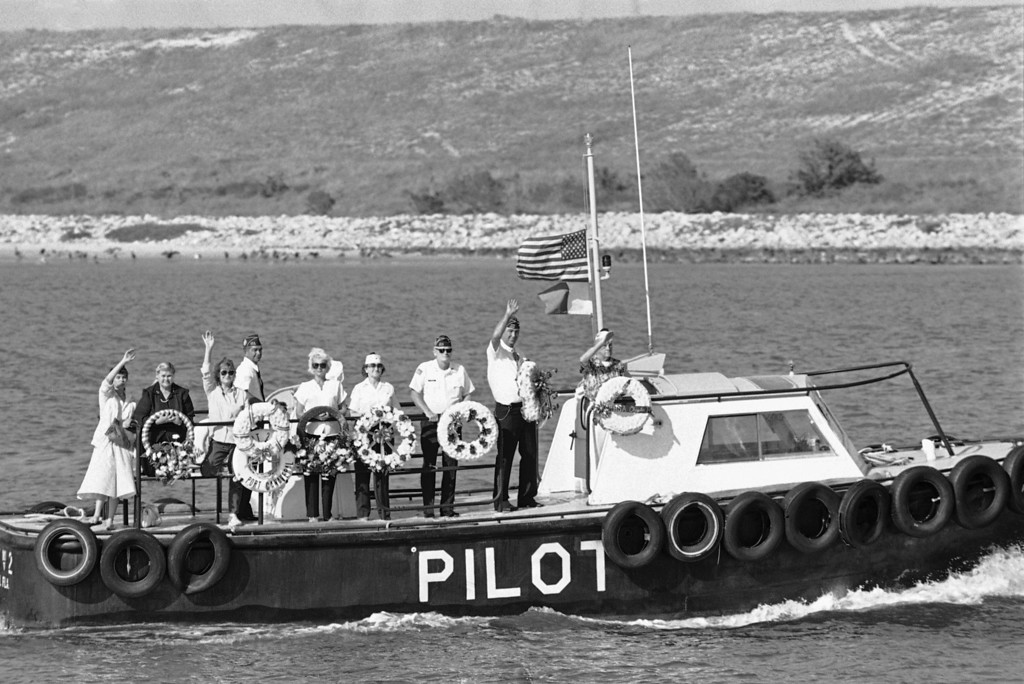 . A delegation from the Veterans of Foreign Wars, Post 10131, Cape Canaveral, Florida carrying seven wreaths, ride a boat into the Atlantic ocean, Monday, Feb. 3, 1986 to drop the wreaths in honor of the seven crew members killed in the explosion of the Space Shuttle Challenger. (AP Photo/Terry Renna)