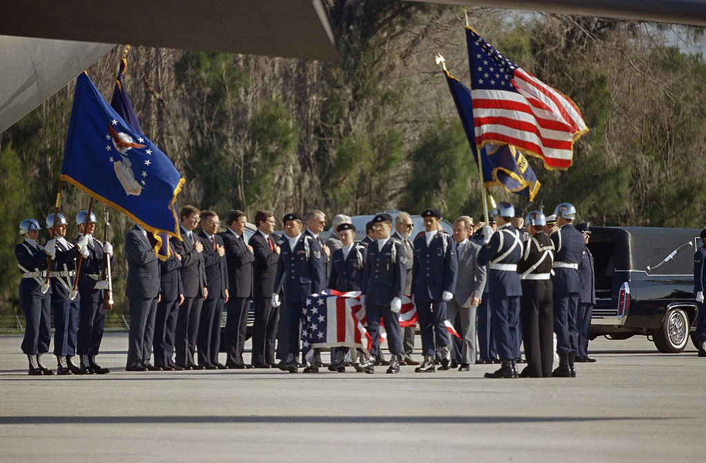. The body of the first teacher chosen for space, Christa McAuliffe, is carried by an honor guard to a C-141 Starlifter jet in Florida, April 29, 1986 where she and six other Space Shuttle Challenger astronauts will be flown to Dover, Del. The Astronauts were killed in Mission 51-L on January 28th. (AP Photo)