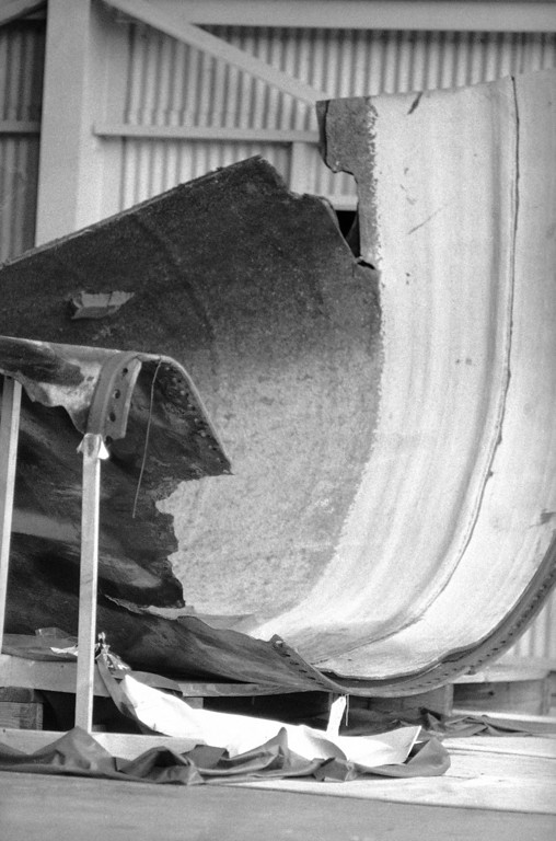 . The front landing gear of the Space Shuttle Challenger as well as other structural components can be seen in this photograph taken in the storage area of the Kennedy Space Centers logistics building on June 12, 1986. NASA has recovered 35 percent of the shuttle, 50 percent of the solid rocket boosters and 15 percent of the external fuel tank.  (AP Photo/James Neihouse)