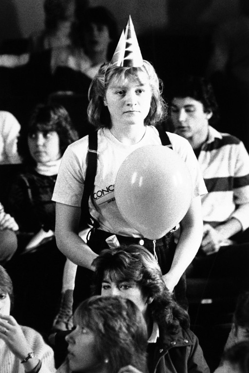 . Senior class President Carina Dolcino is stunned by the news that the space shuttle carrying Concord High School teacher Christa McAuliffe exploded after launch Concord, New Hampshire on Jan. 28, 1986. Students at the school watched the launch on television sets scattered throughout the school. A gala celebration had been planned for a successful launch. (AP Photo/Ken Williams/Concord Monitor)