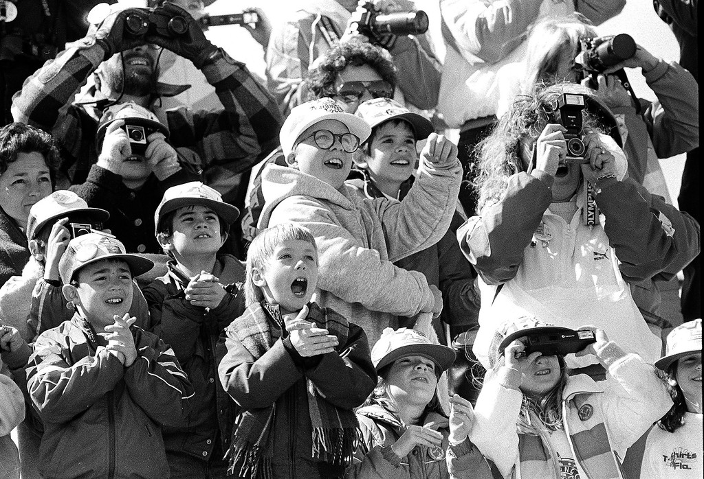 . Classmates of the son of America\'s first school teacher astronaut cheer as the space shuttle Challenger lifts skyward from Pad 39B, Jan. 28, 1986.  Their delight soon turned into horror as the shuttle exploded about 70 seconds into flight.  The boy in the white hat and glasses at center is not a schoolmate but is Peter Billingsley, spokesman for the young astronaut program.  (AP Photo/Jim Cole)