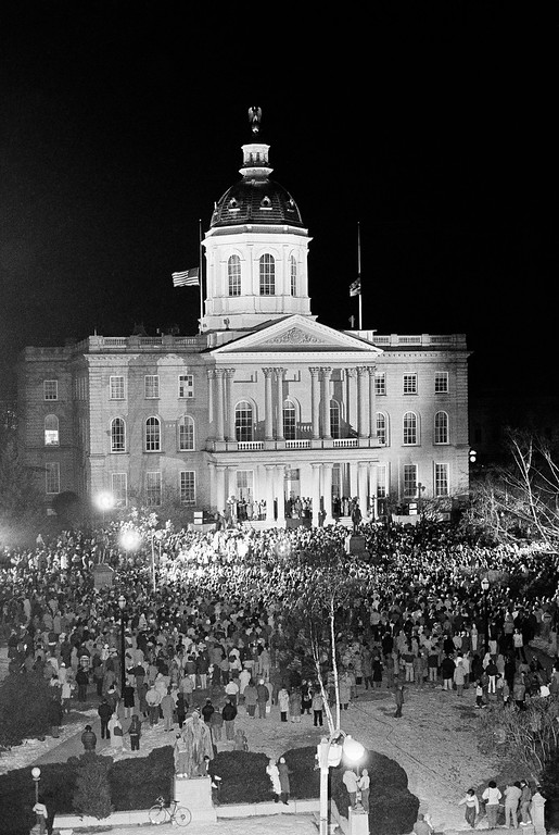 . An estimated crowd of 2500 peopled gather around the foot of the Statehouse steps in Concord, New Hampshire, Friday, Jan. 31, 1986 to participate in a memorial service for Concord High School teacher Christa McAuliffe who was killed in the space shuttle Challenger explosion on Tuesday. (AP Photo/Bob LaPree)