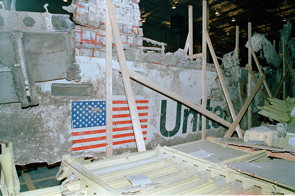. The left side of the Space Shuttle Challenger is seen in a hangar at Kennedy Space Center, Fla., April 9, 1986. Reporters and photographers were allowed to see the wreckage of the shuttle for the first time today. The Challenger exploded just after takeoff on Jan. 28, killing all seven crew members. (AP Photo/Doug Jennings)