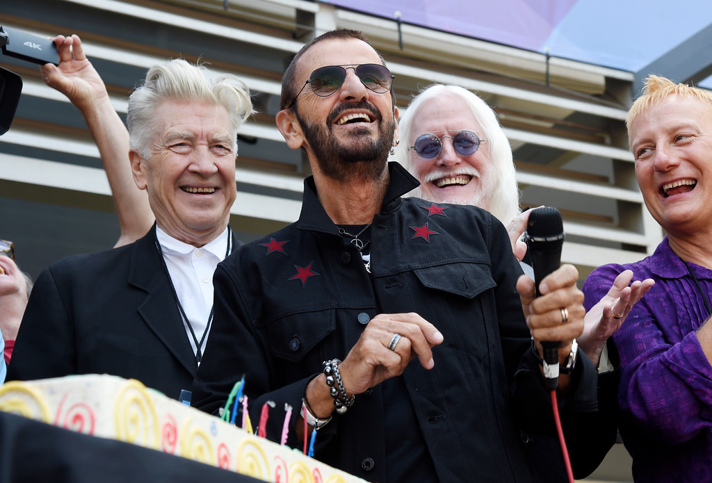 . Ringo Starr, center, is joined by guests including filmmaker David Lynch, left, and musician Edgar Winter, second from right, during a 77th birthday celebration for Starr outside Capitol Records on Friday, July 7, 2017, in Los Angeles. (Photo by Chris Pizzello/Invision/AP)