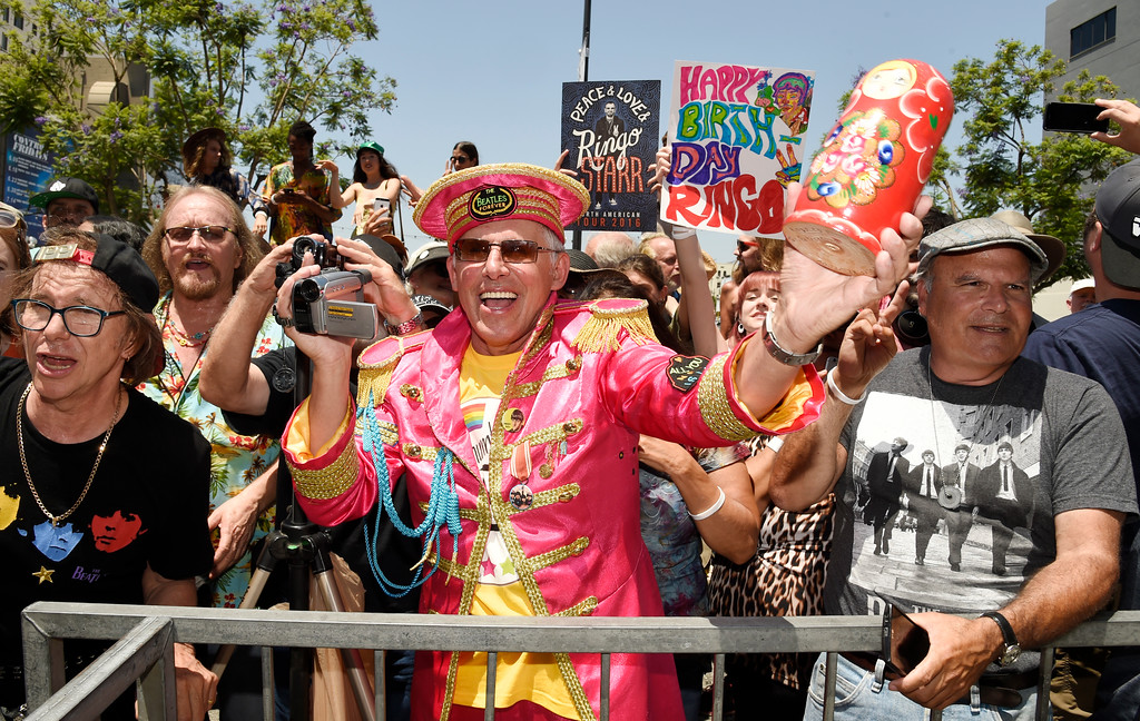 . Oleg Krivtsov, center, of St. Petersburg, Russia, joins other fans in celebrating the 77th birthday of Ringo Starr in front of Capitol Records on Friday, July 7, 2017, in Los Angeles. (Photo by Chris Pizzello/Invision/AP)