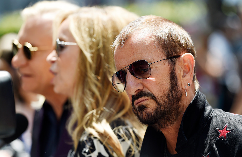 . Ringo Starr, right, is interviewed during a 77th birthday celebration for him at Capitol Records on Friday, July 7, 2017, in Los Angeles. Also being interviewed at left are guitarist Joe Walsh and Starr\'s wife Barbara Bach. (Photo by Chris Pizzello/Invision/AP)