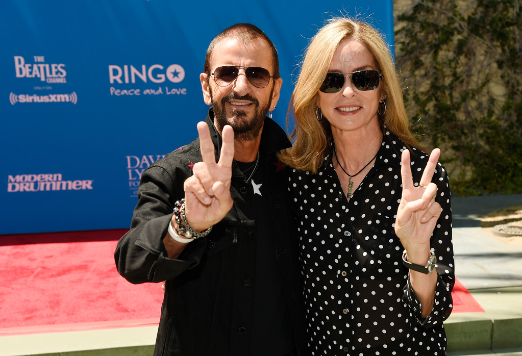 . Ringo Starr and his wife Barbara Bach give the peace sign to photographers during a 77th birthday celebration for Starr at Capitol Records on Friday, July 7, 2017, in Los Angeles. (Photo by Chris Pizzello/Invision/AP)