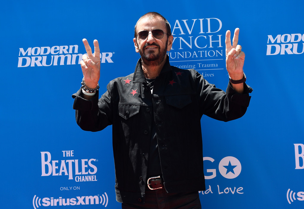 . Ringo Starr poses for photographers during a 77th birthday celebration for him at Capitol Records on Friday, July 7, 2017, in Los Angeles. (Photo by Chris Pizzello/Invision/AP)