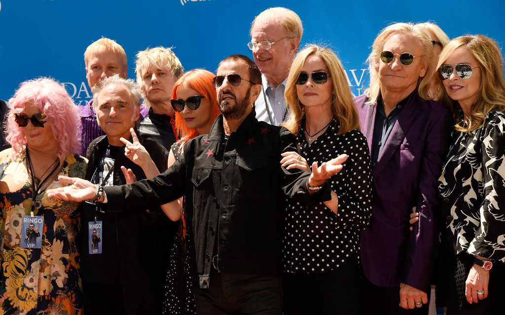 . Ringo Starr, center, is joined by friends and family as he celebrates his 77th birthday at Capitol Records on Friday, July 7, 2017, in Los Angeles. (Photo by Chris Pizzello/Invision/AP)