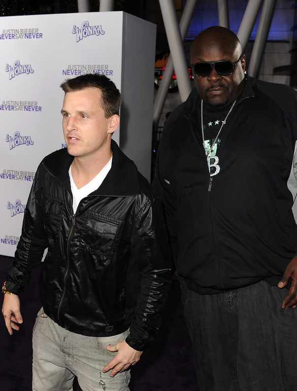". LOS ANGELES, CA - FEBRUARY 08:  Skateboarder Rob Dyrdek (L) and Christopher ""Big Black\"" Boykin arrive at the premiere of Paramount Pictures\' \""Justin Bieber: Never Say Never\"" held at Nokia Theater L.A. Live on February 8, 2011 in Los Angeles, California.  (Photo by Kevin Winter/Getty Images)"